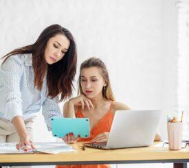 business-office-women-two-work-desk-discuss-earn-extra-money-side-hustle-money-making-entrepreneurs_t20_ax2zGP