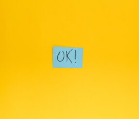 the-word-ok-written-on-a-blue-sticky-note-on-a-yellow-backround_t20_lLBejm (2)